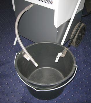 Dehumidifier showing drain to bucket